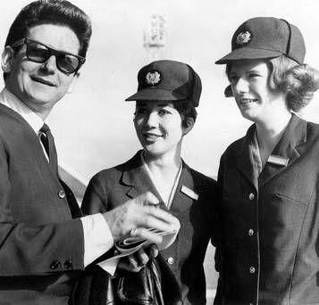 Roy Orbison signs autographs for British Eagle airline hostesses