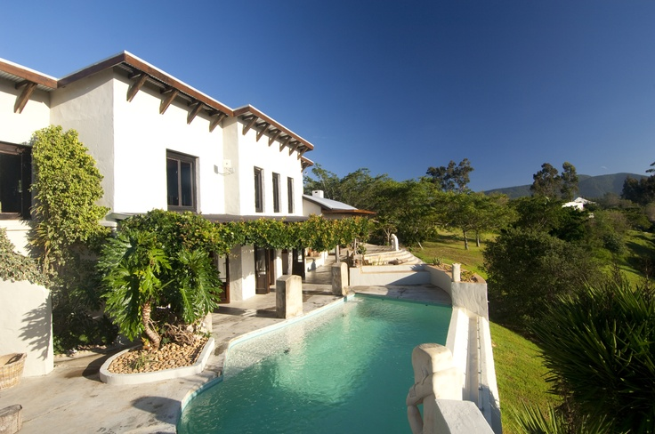 Set on a private estate just outside Plettenberg Bay, The Villa at Hog Hollow is ideal for families or couples travelling together, with beautiful views over the Tsitsikamma Forest and nearby mountain range. #SecretAfrica