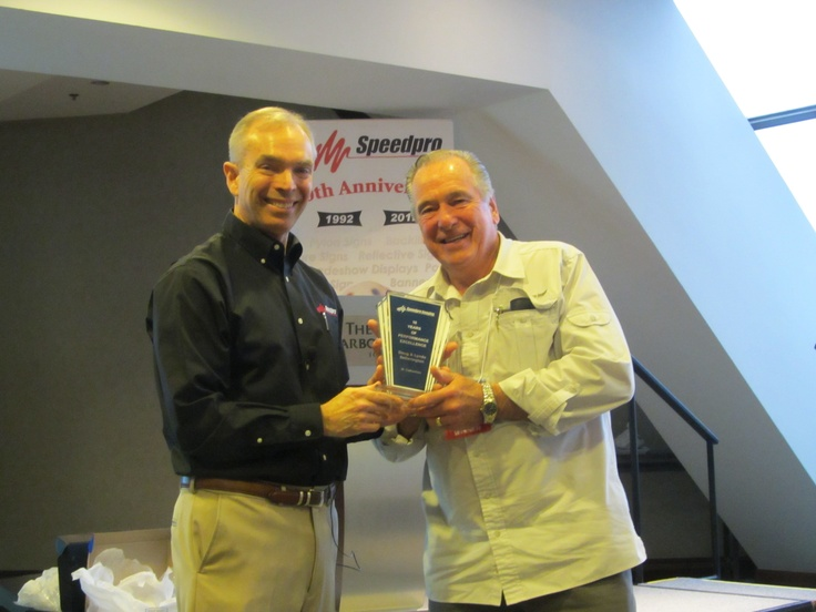 Doug Setterington of Speedpro Imaging St. Catharines accepts his 10th Anniversary award from Speedpro President, Stuart Burns.  Congrats Doug!