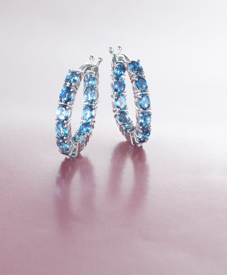 These London blue topaz inside-outside hoops showcase how beautiful the December birthstone can be! The sparkling blue hue shimmers with your every turn. Item no. 785612