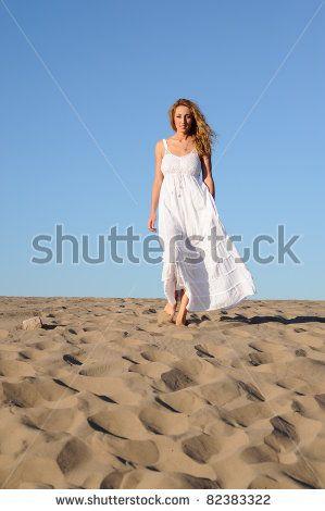 stock-photo-beauty-woman-in-white-dress-walking-in-desert-82383322.jpg (299×470)