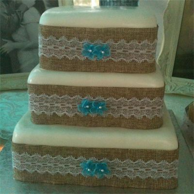 3 Tiered Burlap And Lace Wedding Cake 2 Tiers Are White With Strawberry Filling