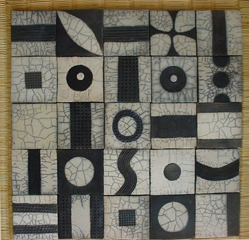 raku -- I like the way that these squares have been divided into ninths. And I'm trying to figure out if this spells something....