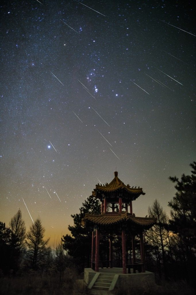 """Geminid meteors over Beijing, China. A stacked image of  more than 20 meteors, taken in just 140 minutes. (Credit and copyright: Steed Yu) Mona Evans, """"Meteor Shower - the Perseids"""" http://www.bellaonline.com/articles/art27461"""
