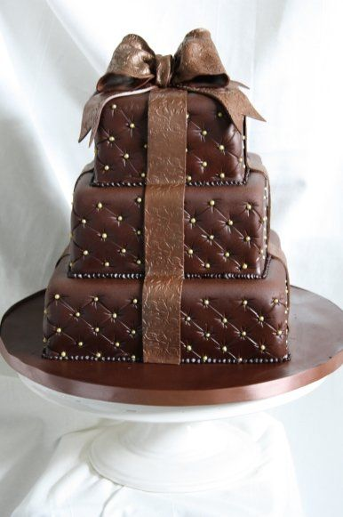 """Luscious Chocolate Wedding Cake - love the look of gilded, wrapped presents with fancy """"Satin"""" bow"""