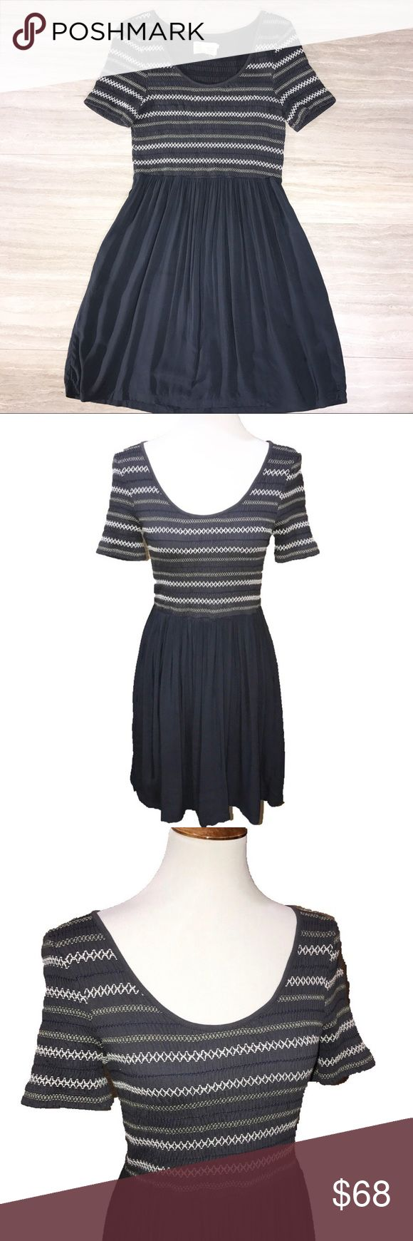 Anthro Saturday Sunday Navy Smocked Fit Flare Anthropologie Saturday Sunday navy blue fit and flare dress. Stretch to fit zig zag stitched smocked top with a flowing swing skirt, hidden side pockets. Anthropologie Dresses Midi