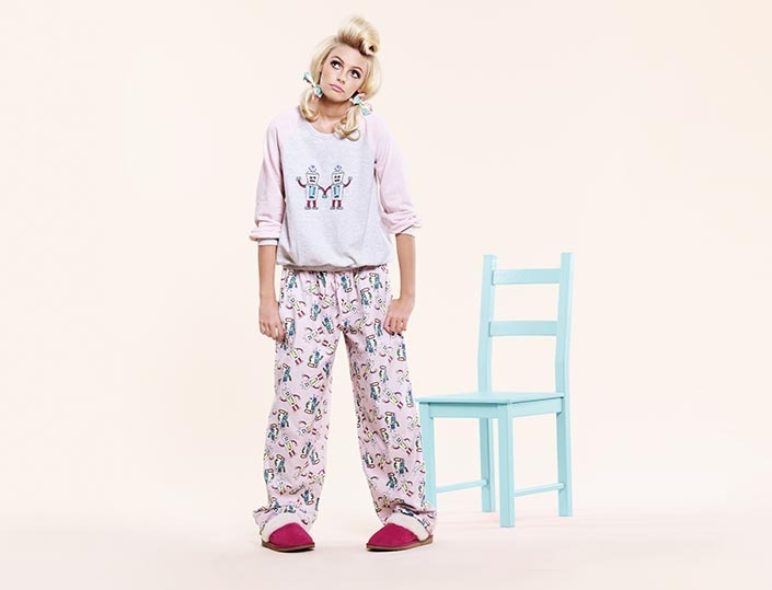 Pajamas are loose-fitting garments derived from the original garment and worn chiefly for sleeping, but sometimes also for lounging, also by both sexes. More generally, pajamas may refer to several garments, for both daywear and nightwear, derived from traditional pajamas and involving variations of .