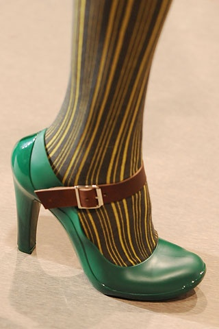 Green shoes and stripy tights!
