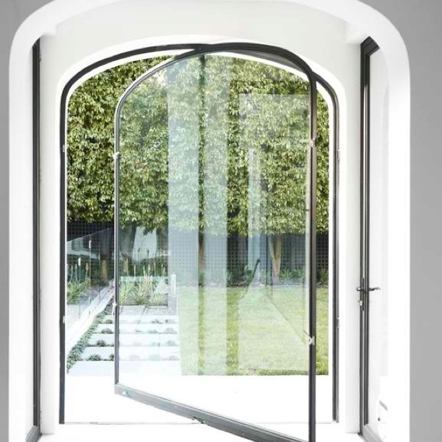 Arch top pivoting glass door doors pinterest arches for Arch door design