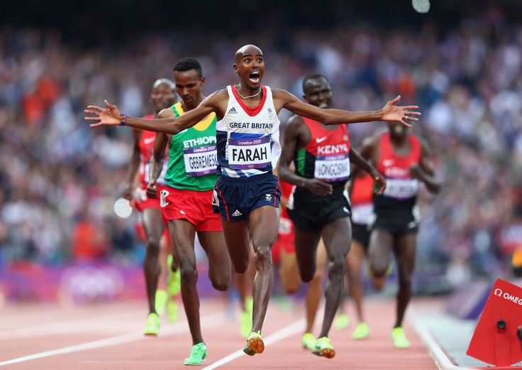 Mo Farah of Team GB crosses the finish line to win gold in the Men's 5000m Final. Mo also wins gold in the 10,000m competition at London 2012 Olympic Games.