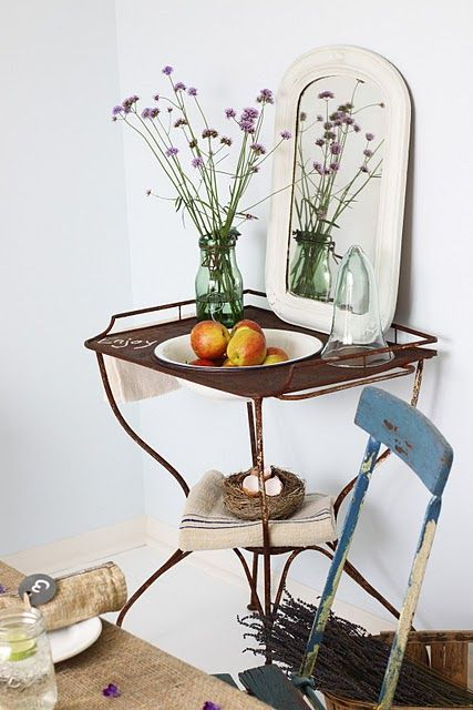 This is an old sink, re-purposed as a side table. She put a large enamel bowl in the space where the sink bowl went. How fun is this?