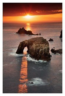 Amazing to see the sunset beaming directly though the openings in the rocks. Fantastic photographerCountry Send, Nature, Sunsets, Sunris, Beautiful, Land End, Places, Cornwall England, Photography