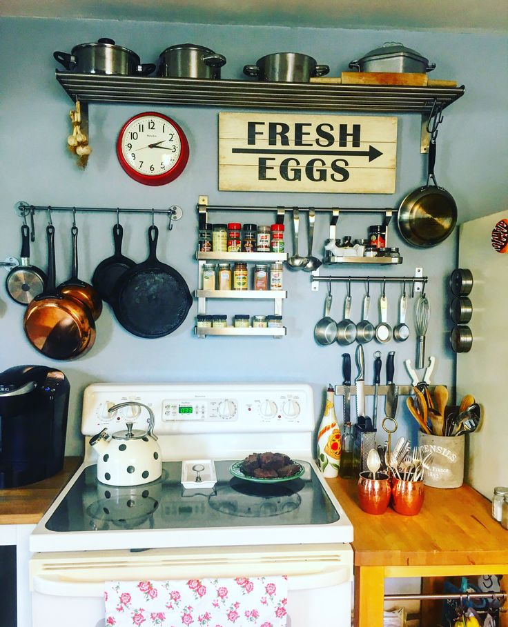 How to add storage with IKEA pot racks and a little farmhouse  charm #ikea #ikeakitchenstorage #wallstoragekitchen #ikeafarmhousedecor #cottagekitchen #bohokitchen #eclectickitchen