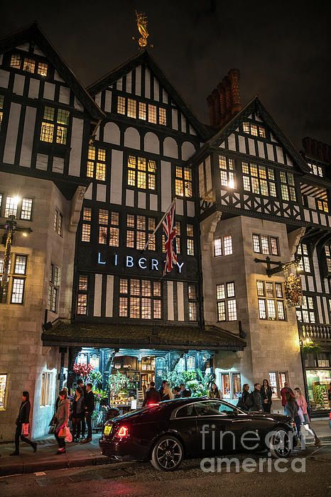 The Famous Liberty of London Department Store out front at night.  Photography by Mike Reid