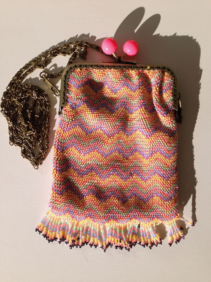 Original creation: Soft beaded pouch. Knitted with silk and delicas beads.