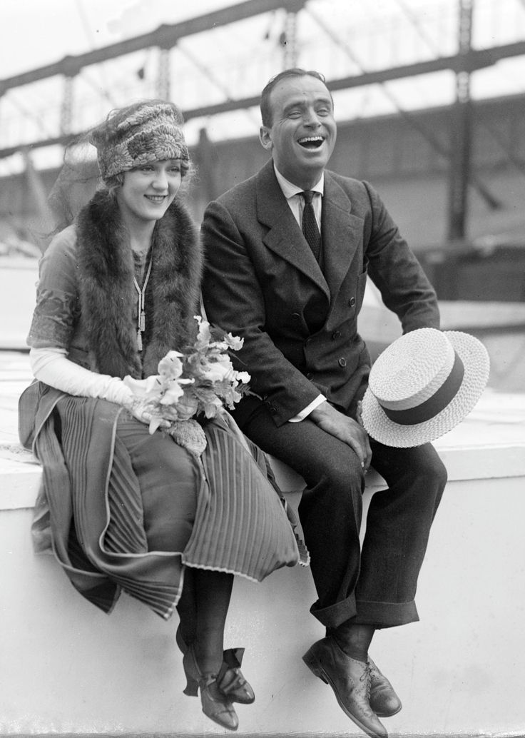 Mary Pickford and Douglas Fairbanks leave their hand and footprints at Grauman's Chinese Theater, as Sid Grauman watches on, 30 April 1927. Description from pinterest.com. I searched for this on bing.com/images