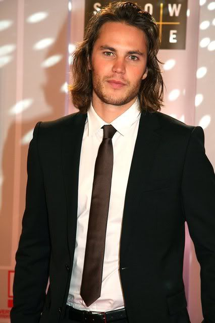 Taylor Kitsch. I never thought I'd like a guy with long hair but woooow