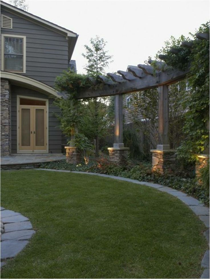 backyard pergola, something like this down the side of the shop building would add interest and doesn't need watering