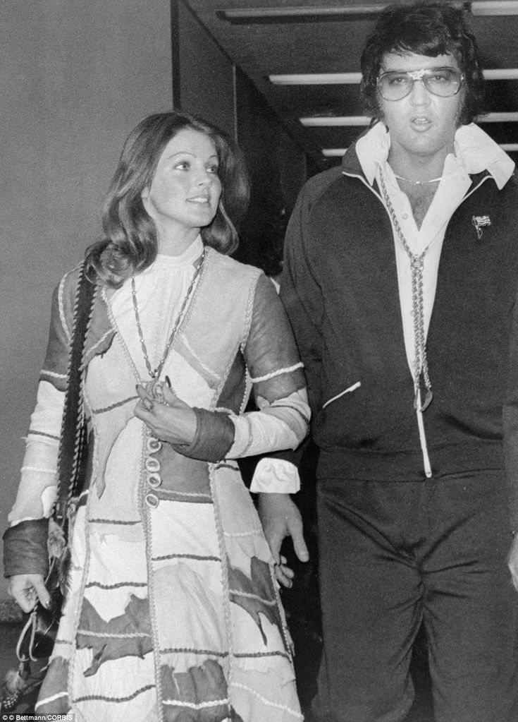 Entertainer Elvis Presley leaves Santa Monica California Superior Court after being granted a divorce from his wife Priscilla, left, in 1973. The couple had been married six years and in spite of the October 9 divorce proceedings, they appeared very amicable as they left the courtroom