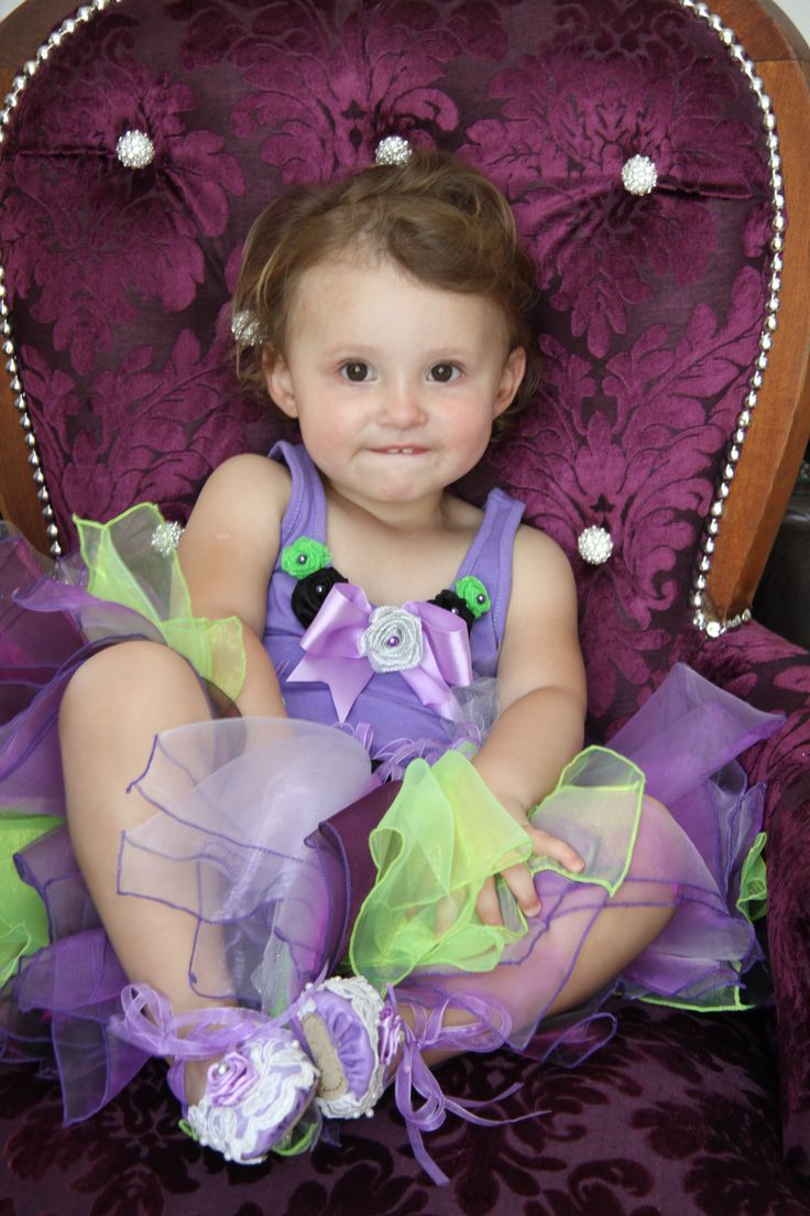 Tutu's made with square pieces of material.  Top with ribbon roses and finished off with pearls