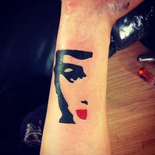 Add a dash of red with pop art Audrey Hepburn. | 32 Cool And Colorful Tattoos That Will Inspire You To Get Inked