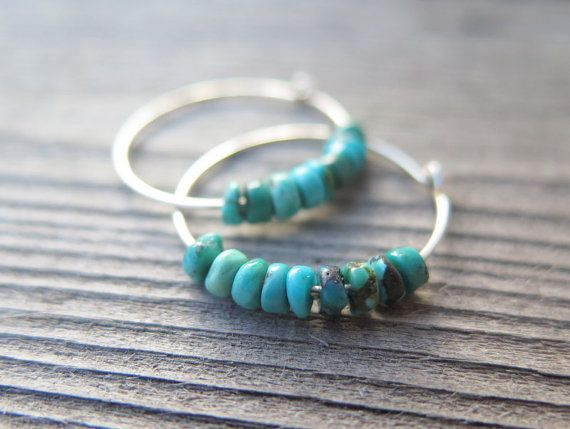 These natural turquoise stone hoops are made with reclaimed sterling silver wire, hammered and forged into smaller hoop earrings. The turquoise stones