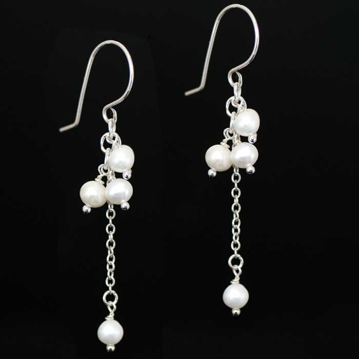 Long elegant earrings featuring five 6mm snow white freshwater pearls dangling on a sterling silver chain and set on sterling silver hooks.  Tana is the perfect design for all occasions, dress them up for the evening or wear with daytime casual for a touch of elegance.  These stylish earrings are also ideal for the modern bride.