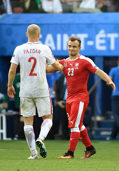 #EURO2016 Poland's defender Michal Pazdan shakes hands with Switzerland's midfielder Xherdan Shaqiri after the Euro 2016 round of sixteen football match...