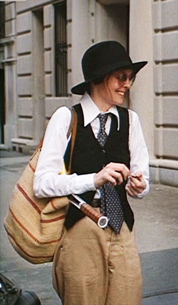 Diane Keaton in Woody Allen's Annie Hall (1970s).  Ruth Morley wardrope stylist. To be an Annie Hall, we need a fedora hat, basic white shirt, black sleeveless blazer, tie, boyfriend trouser,… such an androgynous style!