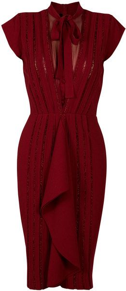 "Dark red dress of a remarkable fabric that has even ""ribbon"" strips of matching lace insets. Tie neckline with a chiffon-covered deep V keyhole. Pencil skirt with large ruffle / flounce down middle. By Eastland"
