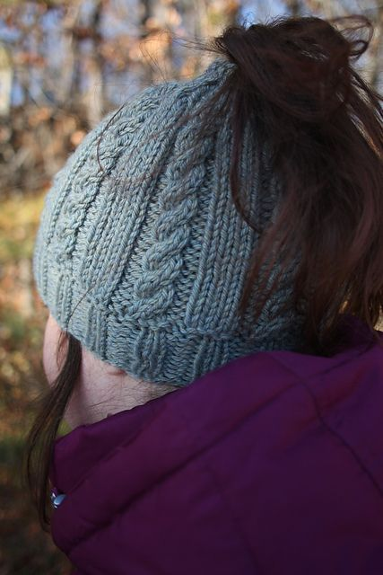 Free Knitting Pattern for Riva Messy Bun Hat - This cable ponytail hat from the Berroco Design Team is a quick knit in bulky yarn.