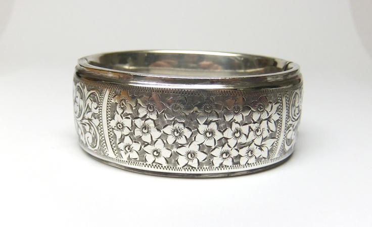 Victorian silver bangle with leaf engraving