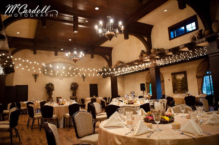 The reception area is so beautiful at Childress, we kept the centerpieces simple -- we used grapevine wreaths surrounding a vase of corks with a pillar candle.