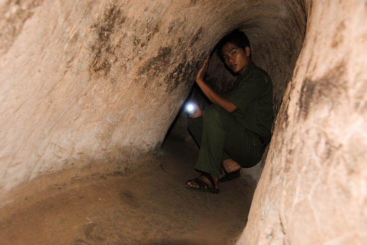 Vietnamese Encounter – Cu Chi Tunnels – Ho Chi Minh City, Vietnam    The Cu Chi Tunnels were used by Viet Cong guerillas during the Vietnam War to gain a key competitive advantage over the American resistance. Today this expansive network of tunnels has turned into one of the largest tourist attractions in southern Vietnam.    I took this picture back in 2010 while on a tour of the tunnels outside of Ho Chi Minh City. I remember the tunnels were dark, hot, and my long ...