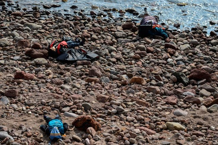 Three bodies are seen washed up on a beach in Canakkale, Turkey after at least 37 migrants and refugees were killed when their boat sank in the Aegean while trying to cross to Greece on Jan. 30, 2016.