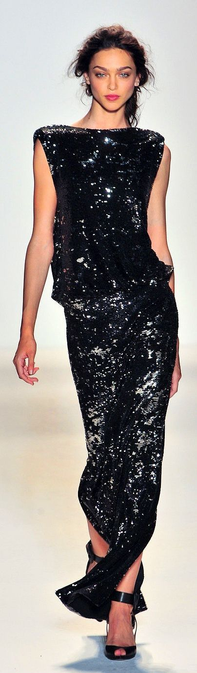black sequins, not too flashy, perfect lines and draping. Love the weight at the hemline... gives that extra appeal when walking. All around A plus take on a classic staple.