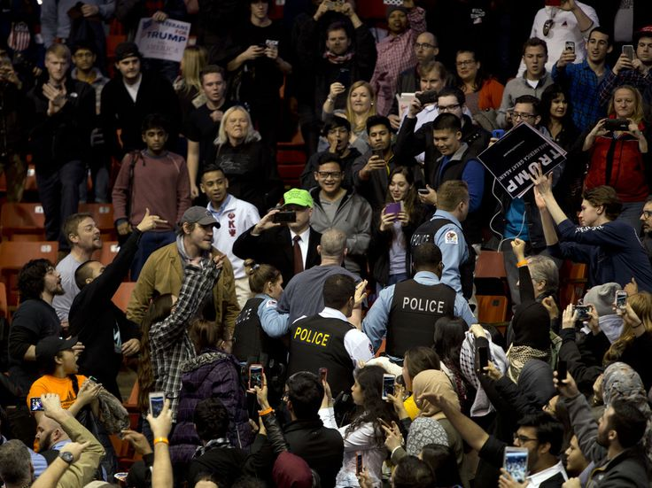 Anti-Donald Trump protesters confront his supporters during a Trump rally at the UIC Pavilion in Chicago on March 11, 2016.