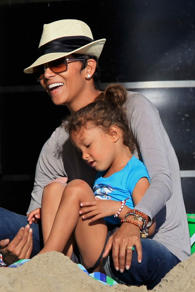 Halle Berry and Nahla. Great hat, glasses and diamond stud earrings combo!