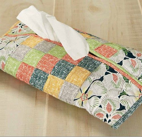 This simple home décor project will look great in a living room, bedroom, office or bathroom. Wrap your tissues up in modern patchwork. Measures 16