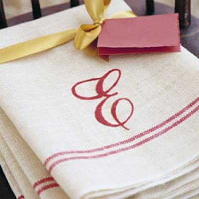 embroider on the 79 cent dishtowels from IKEA. use them as giftwrap -- for a cookbook, or cooking utensils.