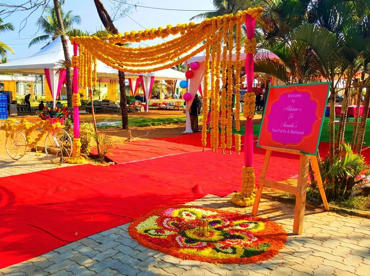 The welcome sign and the flower rangoli is inviting and colourful. www.shopzters.com