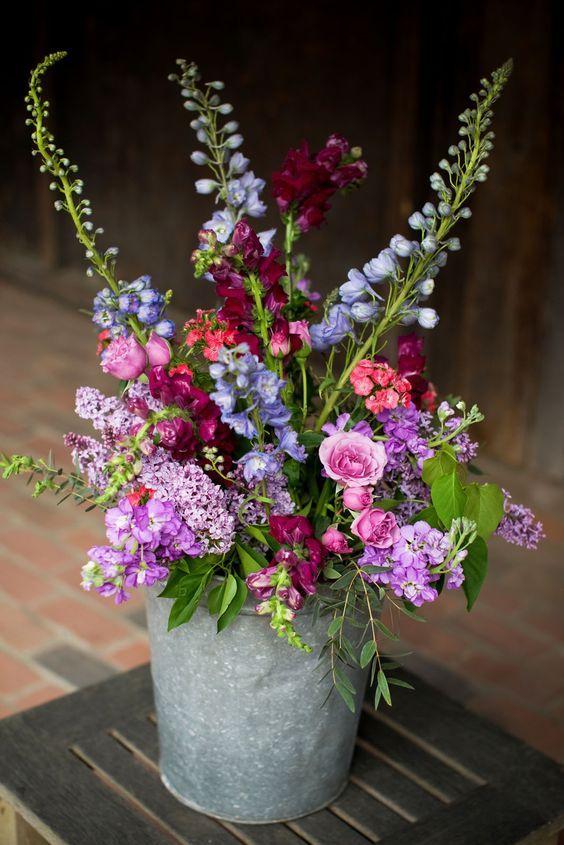 Purple pink and blue wedding flowers / http://www.deerpearlflowers.com/rustic-buckets-tubs-wedding-ideas/