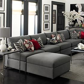 Grey Living Room....sectional, switch the red for purple and this is the family room Id like!