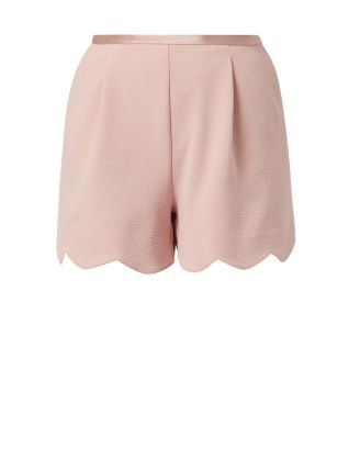 As an alternative to a smart skirt, these Shell Pink Scallop Hem Suit Shorts are both feminine and stylish.