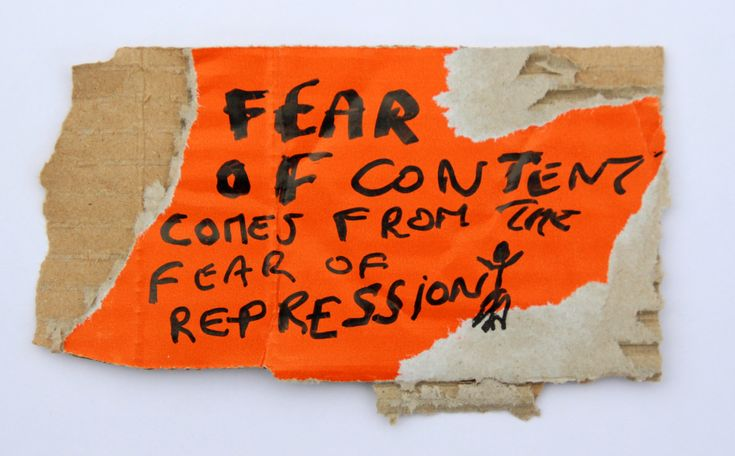 Fear of content comes from the fear of repression, black marker text and drawing on carton, 19 x 10 cm