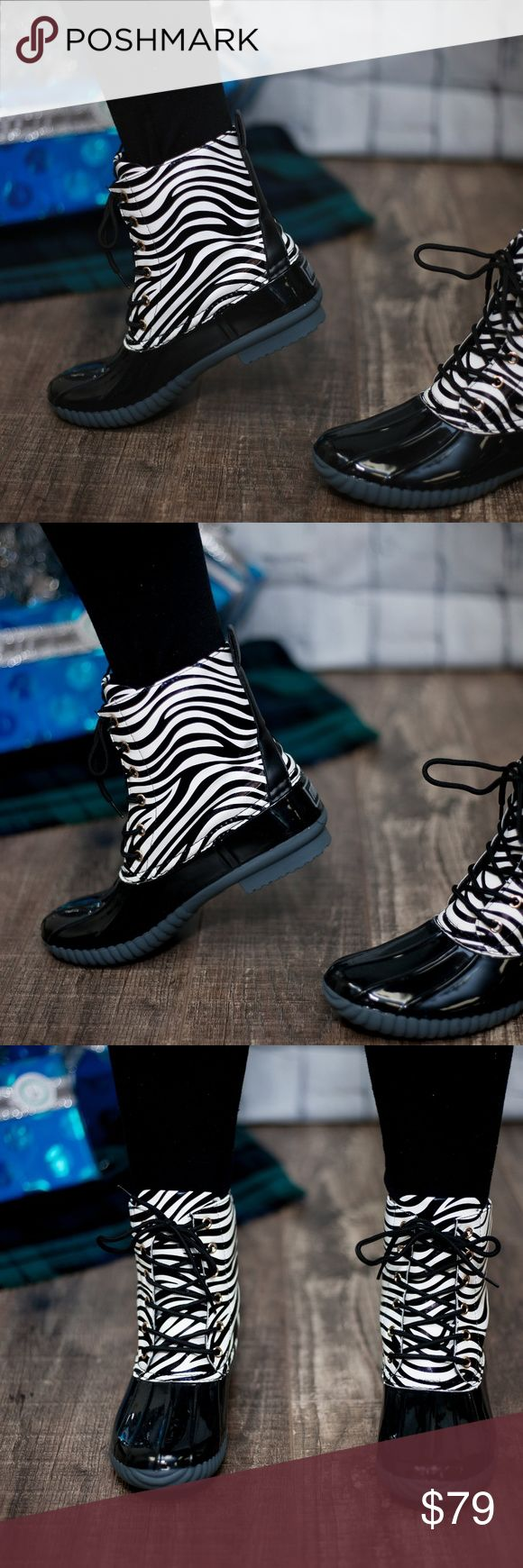 Zebra Print Duck Boots This listing is for zebra. These are selling like crazy!! $79 each or $130 for 2 pairs. Select lining in each boot to keep you comfy. Stitched synthetic rubber sole for durability and grip  Price FIRM unless bundled. Kyoot Klothing Shoes Winter & Rain Boots
