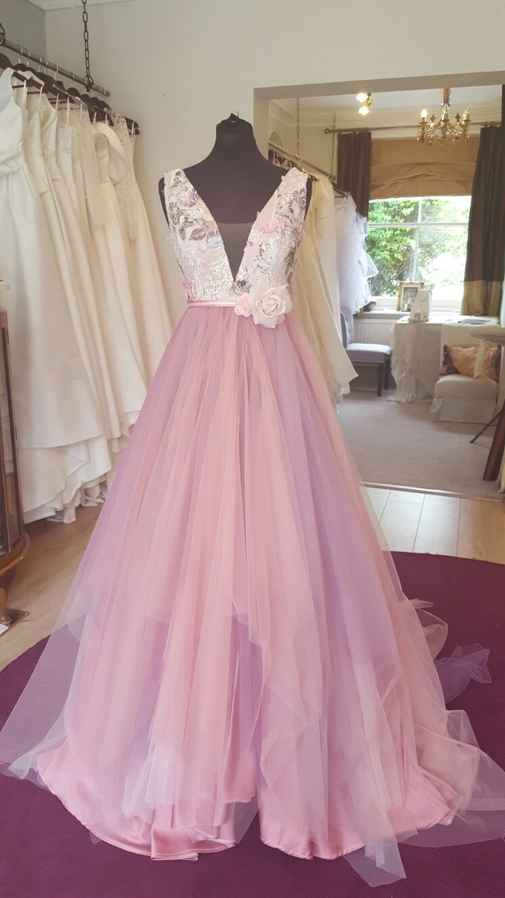 A beautiful floral bodice with pink tonal handkerchief skirt. WOW factor  @larab_bridal