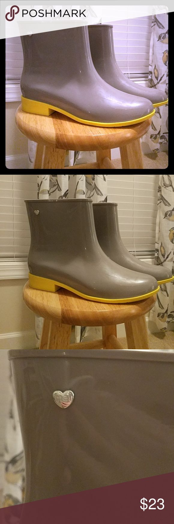 Mel grey and yellow ankle rain boots SALE!! Mel brand Women's grey and yellow ankle height rain boots, size 10  Lightly worn ( see photos) Super cute and perfect for spring rain showers!   Bundle and save! Mel by Melissa Shoes Winter & Rain Boots