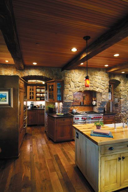 I really like the  stone walls and textured detail in the wood floors and the wood celing