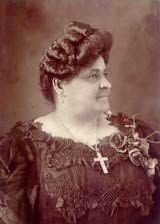 The daughter of an ex-slave, Maggie Lena Walker (1867-1934) became the nation's first woman to charter a U.S. bank, as well as serve as its president 1903-1932.  She taught grade school for 3 years until 1866 when she married a brick contractor, had 2 sons, purchased a home in 1904, and became a widow in 1915. Her health gradually declined, and by 1928 she was using a wheelchair due to paralysis. She remained active, thus becoming an example for people with disabilities.
